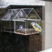 Acrylic window feeder house